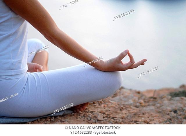 Yoga Shiromani Lena Tancredi, doing yoga in nature, in Ibiza, Spain