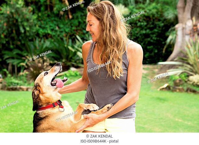 Woman stroking excited dog