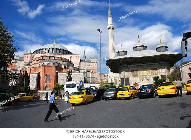Yellow Taxi in front of the Hagia Sophia in Istanbul
