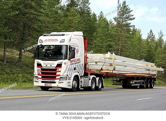 Next Generation Scania R500 of Ismo Partanen for AT Special Transport hauls oversize industrial object on road. Ikaalinen, Finland - August 9, 2018