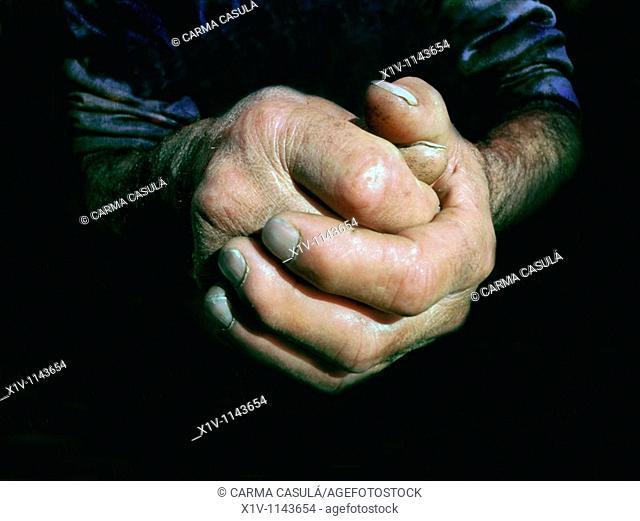 rough hands of an older man