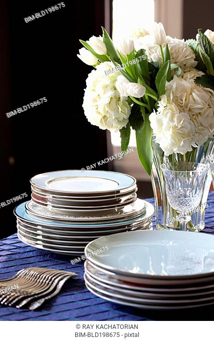 Plates and silverware on table