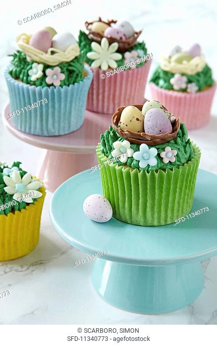 Easter cupcakes topped with cream and sugar decorations