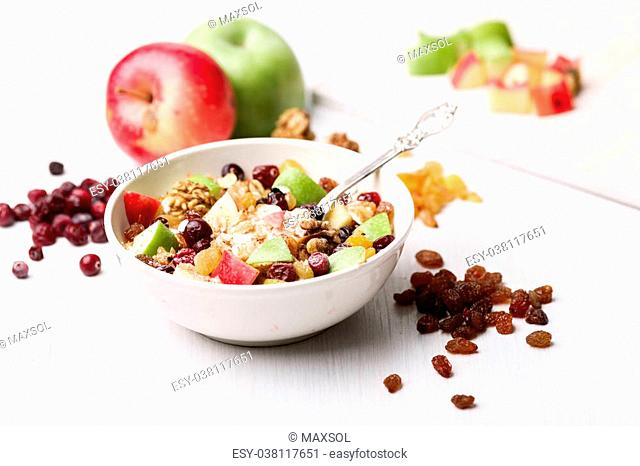 Oatmeal with dried cranberries, black and golden raisins, red and green apples, walnuts and maple syrup. Healthy eating