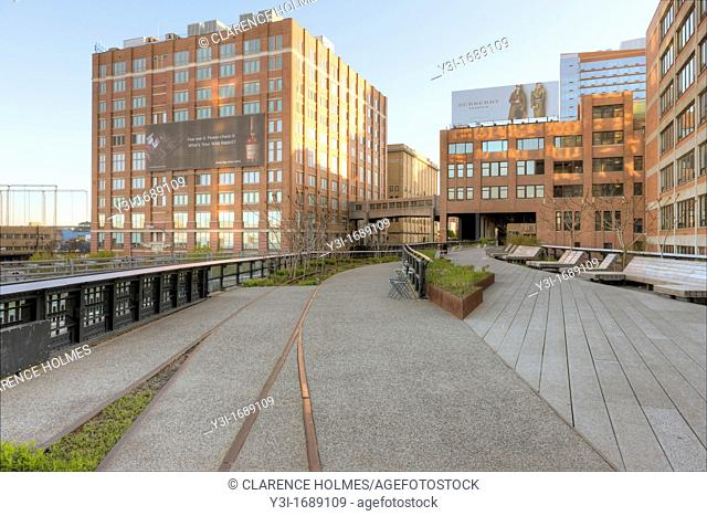 A view of High Line Park, including old railroad tracks left in place, and the surrounding area. The High Line is an urban aerial greenway reclaimed from the...