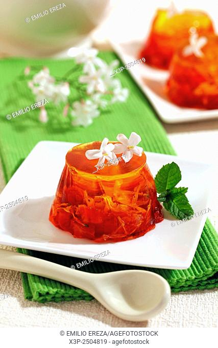 Gelatin with red berries and jasmine flowers