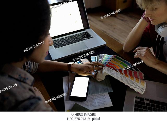 Desires examining color swatches in office