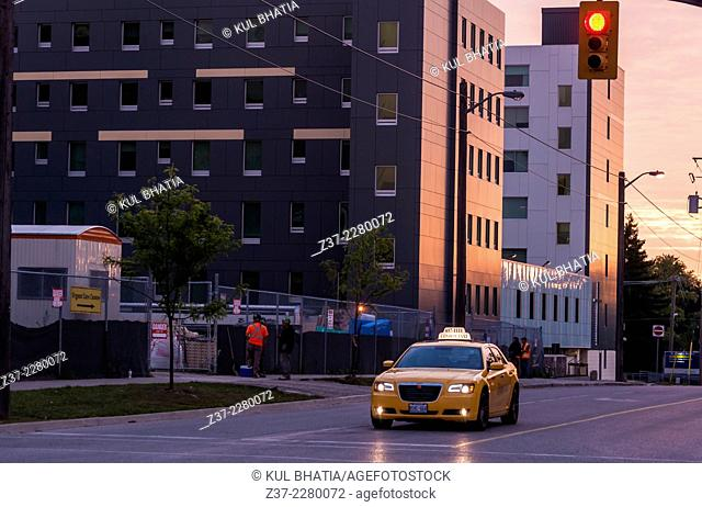 A yellow taxi looking for fares as a new day begins in Ontario, Canada