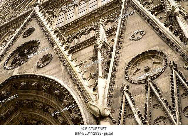 Low angle view of ornate cathedral archways, Paris, France