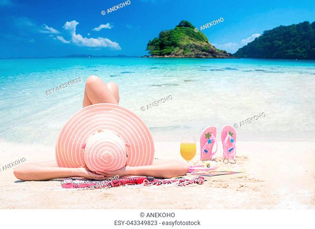 Lady sleep and relax on the beach in Thailand resort, this photo can use for Travel, relax, beach, summer, and Holiday concept