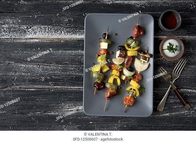 Vegetables skewers on a grey platter