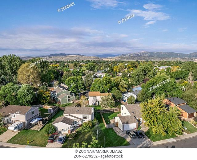 FORT COLLINS, CO, USA - SEPTEMBER 21 2014: Aerial view of typical residential neighborhood along Front Range of Rocky Mountains in Colorado, late summer