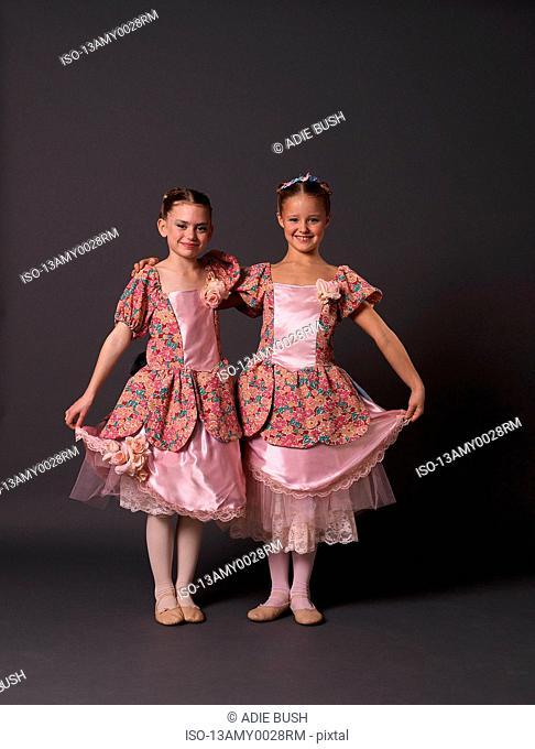 Two ballerinas in pink posing
