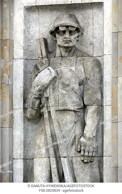 Reminders of communist era, reliefs of heroic workers. here heroic ironmaster, Marszalkowska street in Warsaw. Poland