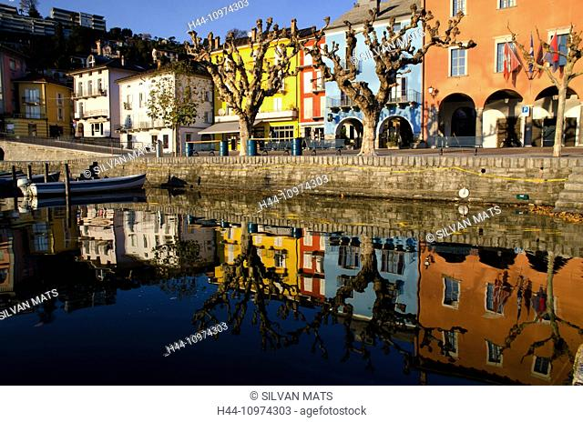 Old houses in ascona reflected in the water in Ascona, Switzerland