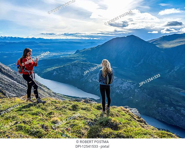 Two women exploring the mountains and wilderness of the Yukon, feeling alive and vibrant in the beautiful scenery around Haines Junction