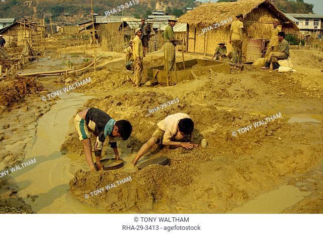 Children sieving and washing small gems from mine waste, Mogok ruby mines, near Mandalay, Myanmar Burma, Asia