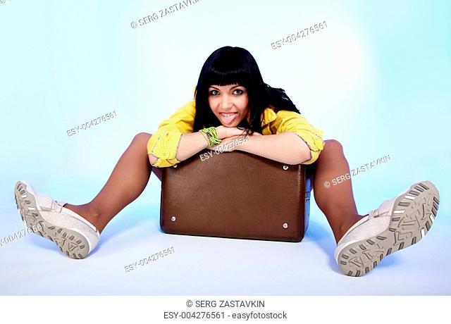 beautiful brunette with suitcase