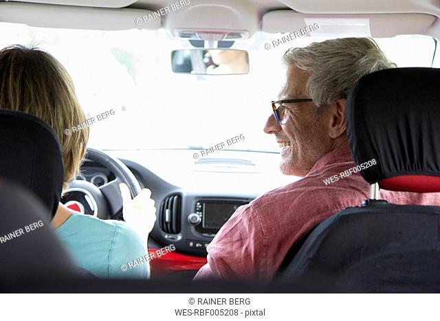 Happy mature couple in car