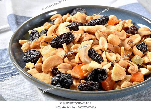 Closeup of a bowl of trail mix with tropical fruits