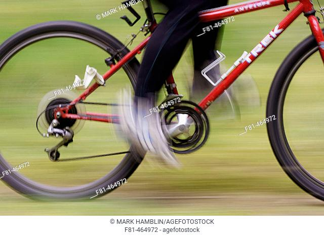 Close-up of cyclist riding mountain bike. Scotland, UK