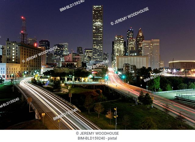 Blurred motion view of traffic and Houston cityscape illuminated at night, Texas, United States