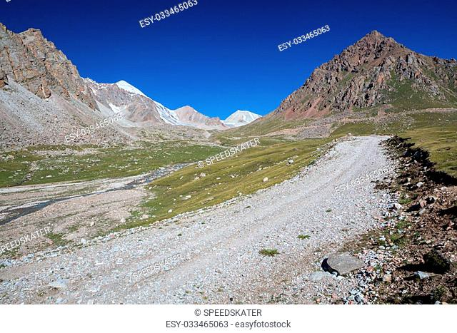 Gravel road in mountains. Tien Shan, Kirghizia