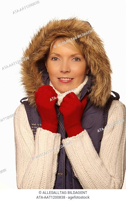 Portrait of a freezing woman with red gloves
