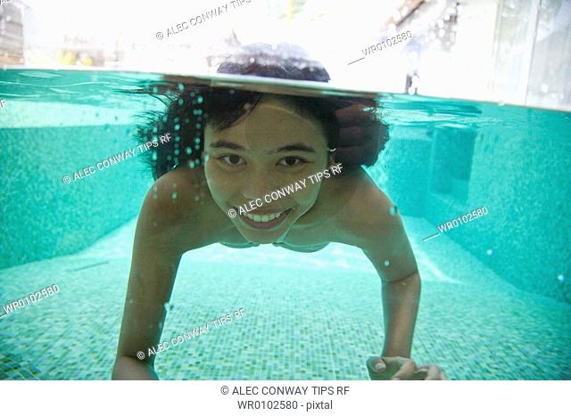 Maldives, South Male Atoll, asian woman in swimming pool