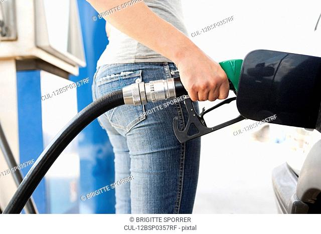 Young Woman at Gas Station