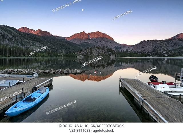 Alpenglow sunrise on Caron Peak and reflections on beautiful Gull Lake, in the Eastern Sierra Mountains, California, USA