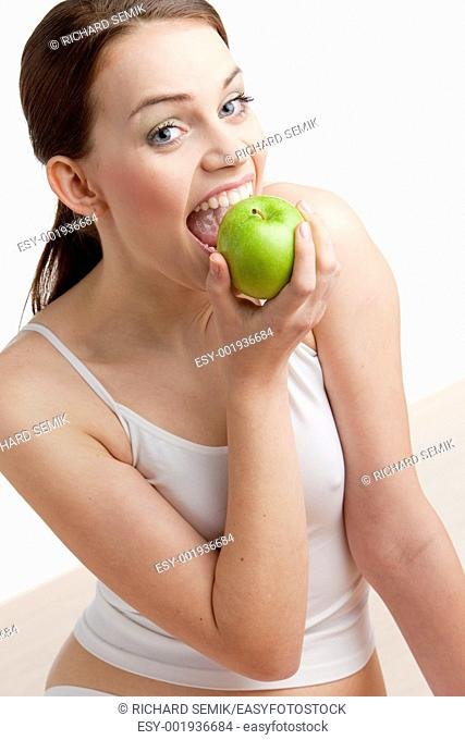 portrait of woman with green apple