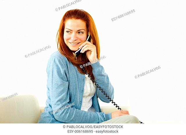 Portrait of a young pretty lady using a phone and smiling