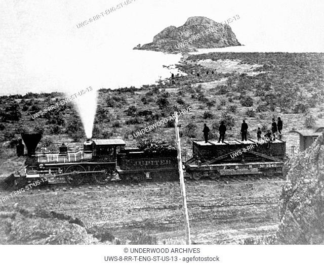 Monument Point, Utah: c. 1868 The Central Pacific Railroad's Jupiter engine seen from Monument Point during the construction of the transcontinental railroad on...
