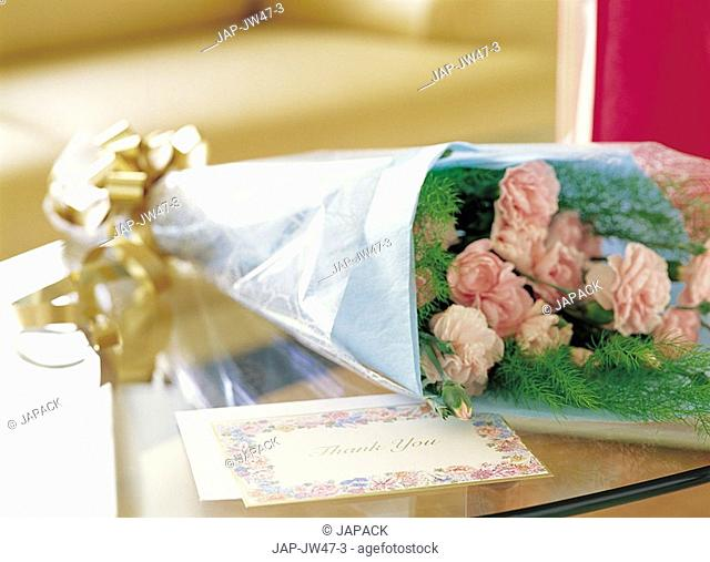 Flowers wraped as gift with card