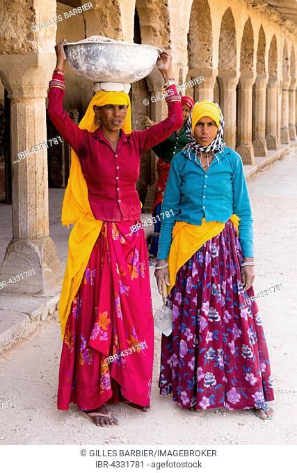 Construction workers at Chand Baori Step Well, Abhaneri, near Jaipur, Rajasthan, India