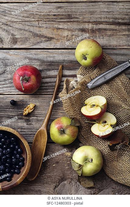 Blueberries, apples on rustic background