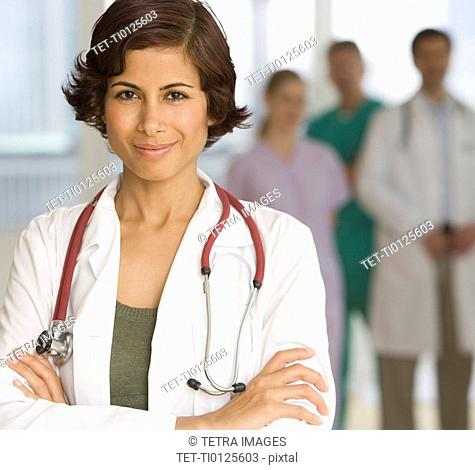 Female doctor with arms crossed