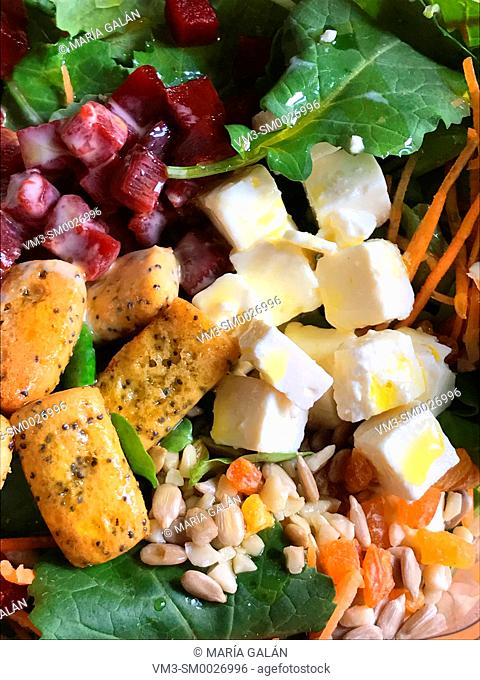 Salad made of cottage cheese, beetroot, rocket, seeds, toast and olive oil