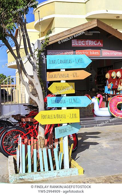 Route and distance signs outside a souvenir shop in Santa Maria, Sal Island, Salinas, Cape Verde, Africa