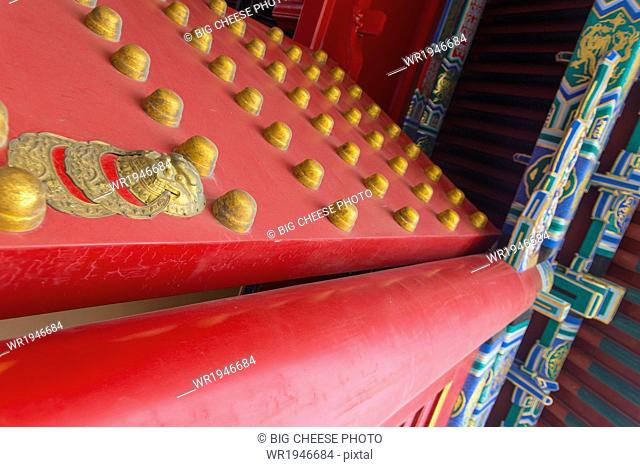 Close up of the ornate red and gold palace gates in the Forbidden City, Beijing, China