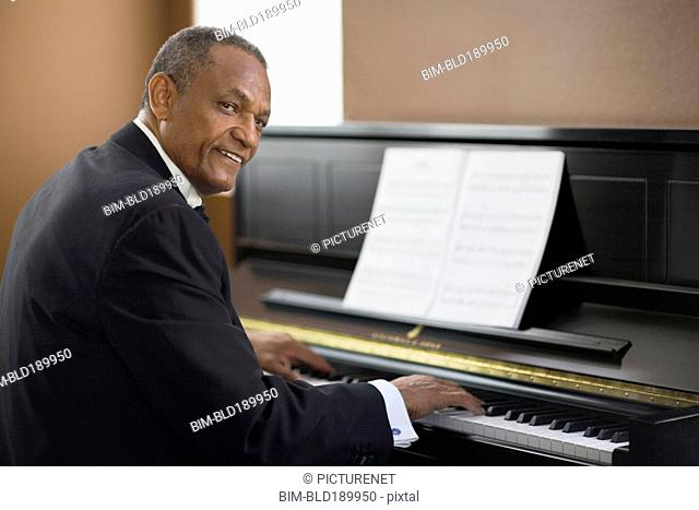 African man playing piano