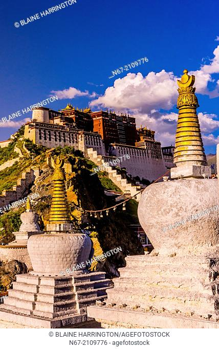 The Potala Palace (a UNESCO World Heritage Site) with stupas in front. It was the chief residence of the Dalai Lama until the 14th Dalai Lama fled to Dharamsala