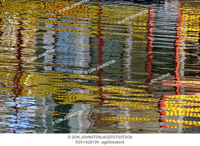 Reflections of buildings in the Inner Harbour waters Victoria, BC