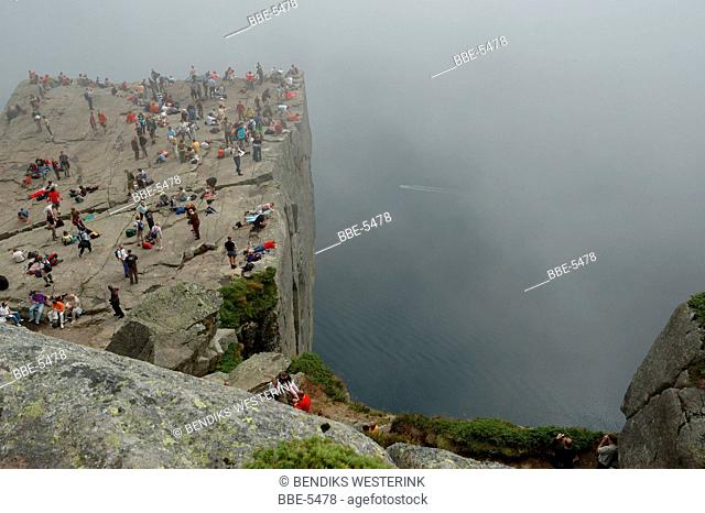 Tourists on the Pulpit Rock along the Lysefjords