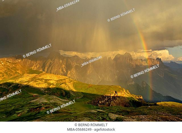 Italy, region Trentino South Tirol, province Bolzano, the Dolomites, to Schlern, thunderstorm and rainbow about the rose garden massif
