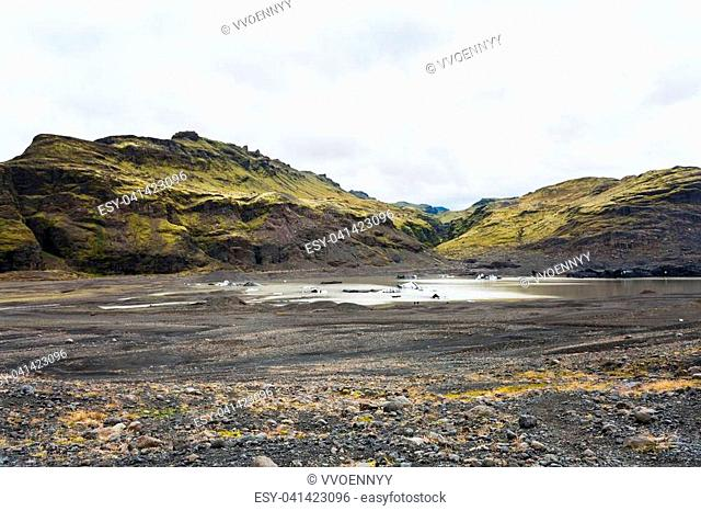 travel to Iceland - bed of Solheimajokull glacier (South glacial tongue of Myrdalsjokull ice cap) in Katla Geopark on Icelandic Atlantic South Coast in...