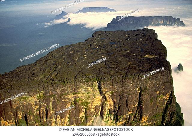 Aerial view of the northern section of Cukenan-Tepuy with Yuruani-tepuy and Ilu-tepuy in the background. Canaima National Park, Bolivar State