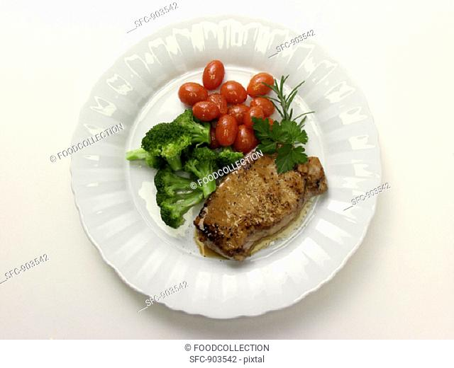 Boneless Pork Chop with Broccoli and Cherry Tomatoes