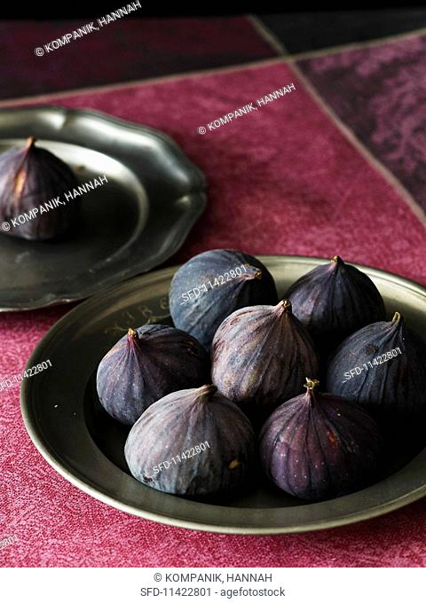 Fresh red figs on a pewter plate